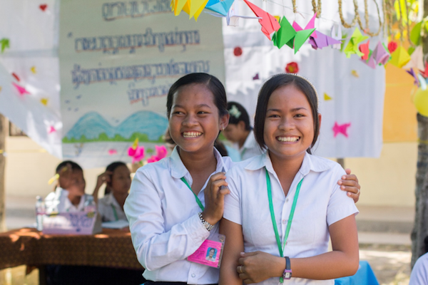 Socheata and Sodanet smile after winning the debate, organized twice yearly by Cambodia Room to Read's Girls' Education Program